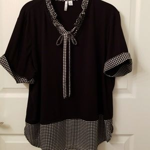 Black and white checker blouse.